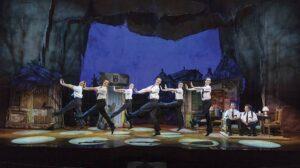A group of elders dancing on stage